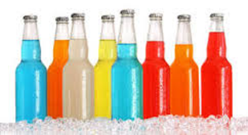Colorful bottles of sodas on ice