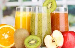 Orange, Kiwi and Apple Juice in Glasses