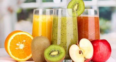 Orange, Kiwi and Apple Juice in Glasses on Table with Fresh Fruit