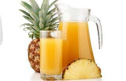 Glass and Pitcher of Pineapple Juice with Fresh Pineapple